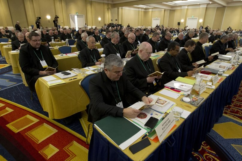 Catholic bishops participate in a morning prayer June 11, 2019, during the U.S. Conference of Catholic Bishops' spring 2019  meetings in Baltimore. (AP Photo/Jose Luis Magana)