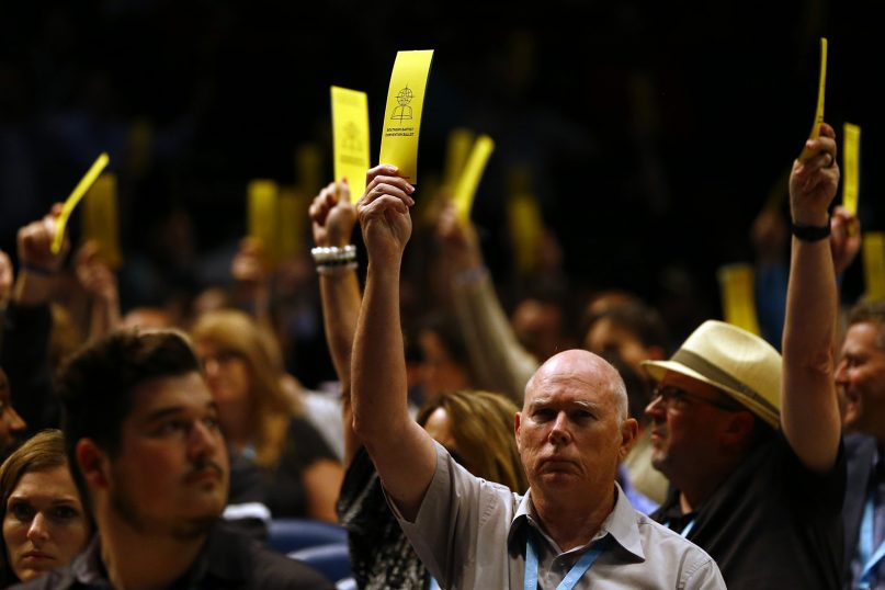 Messengers vote in favor on the amendment of SBC Constitution Article III, Section 1, on sexual abuse during the annual meeting of the Southern Baptist Convention at the Birmingham-Jefferson Convention Complex, June 11, 2019, in Birmingham, Ala. RNS photo by Butch Dill
