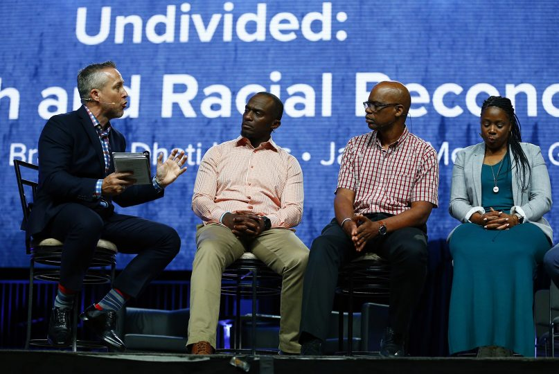 FILE - SBC President J.D. Greear speaks on a panel discussion about racial reconciliation during the annual meeting of the Southern Baptist Convention at the BJCC, June 11, 2019 in Birmingham, Ala. Membership across racial lines has been a topic of conversation in the last year, leading Dr. Marshal Ausberry, Sr., to plead with members not to leave yet. RNS photo by Butch Dill