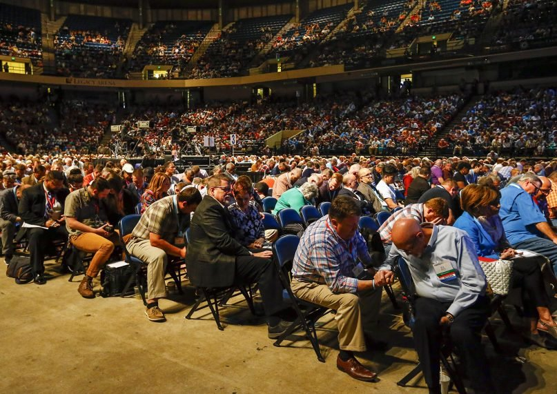 Messengers pray during the annual meeting of the Southern Baptist Convention at the BJCC, June 11, 2019 in Birmingham, Alabama.  RNS photo by Butch Dill