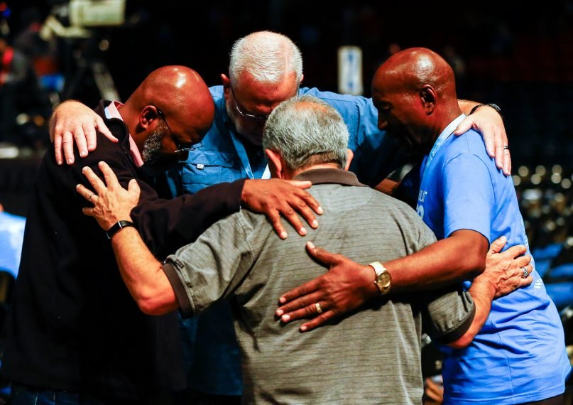 Messengers pray during the annual meeting of the Southern Baptist Convention at the BJCC, June 12, 2019 in Birmingham, Alabama.  RNS photo by Butch Dill