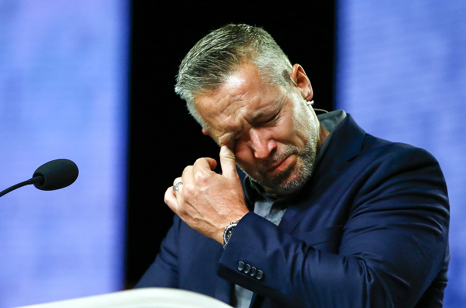 Southern Baptist Convention President J.D. Greear cries during a lamenting prayer for the sexual abuse that has occurred in the church. The prayer took place June 12, 2019, during the annual meeting of the Southern Baptist Convention at the Birmingham-Jefferson Convention Complex in Birmingham, Ala. RNS photo by Butch Dill