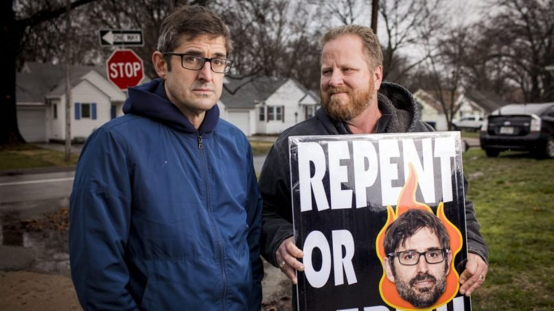 Filmmaker Louis Theroux, left, with Westboro Baptist Church elder Steve Drain with a WBC sign featuring Theroux's head. Photo courtesy of BBC