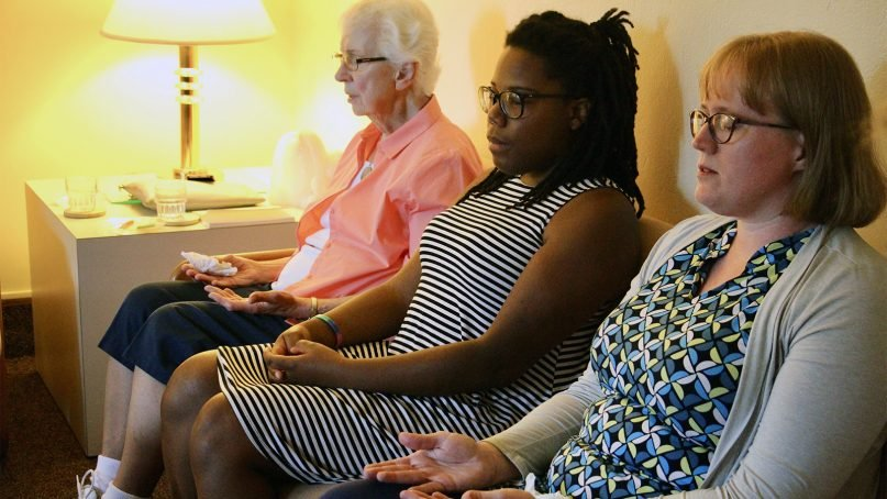 Sister M. Lucille Janowiak, from left, Kendra Avila and Sarah Weinreis Clark spend a few moments in contemplative silence at the beginning of a Sisters and Seekers meeting on July 7, 2019, at the Dominican Center at Marywood in Grand Rapids, Michigan. RNS photo by Emily McFarlan Miller