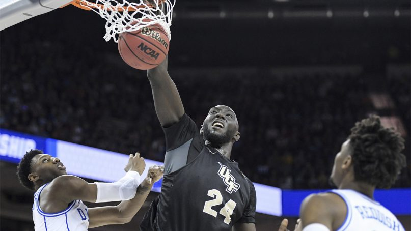 Central Florida center Tacko Fall (24) dunks the ball against Duke forward RJ Barrett, left, as Cam Reddish (2) looks on, during the second half of a second-round game in the NCAA men's college basketball tournament on March 24, 2019, in Columbia, S.C. (AP Photo/Sean Rayford)