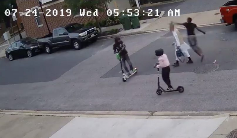 Three individuals attack a 59-year-old Muslim man early July 24, 2019, in Baltimore. Video screenshot via ATF Baltimore