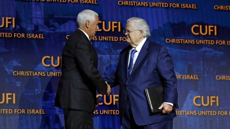 Vice President Mike Pence, left, greets the Rev. John Hagee, founder and chairman of Christians United for Israel, before speaking at CUFI's annual summit on July 8, 2019, in Washington. (AP Photo/Patrick Semansky)