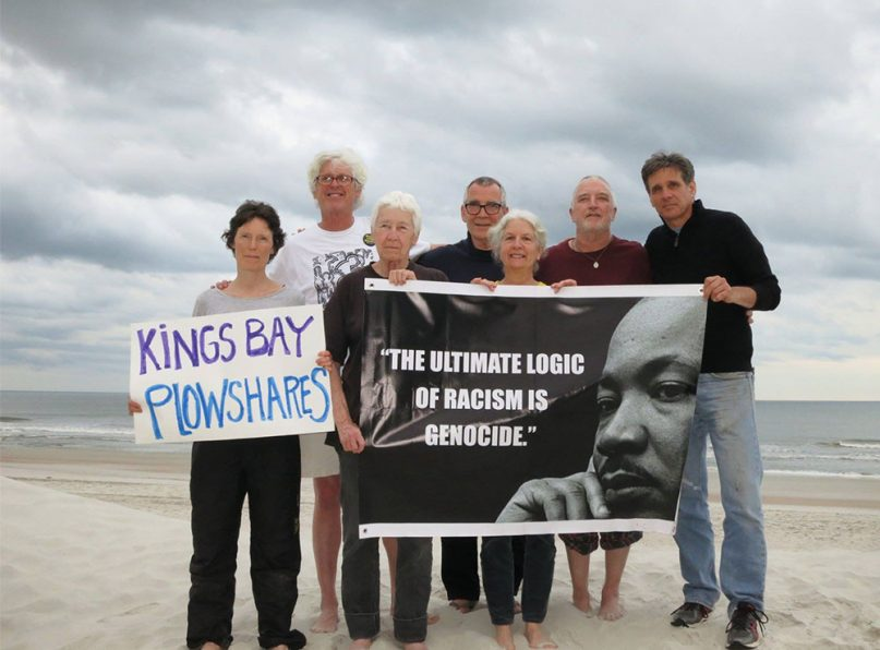 The Kings Bay Plowshares 7. Martha Hennessy, fifth from left, and Carmen Trotta, far right, were released early from their sentence this week. Photo courtesy of the Kings Bay Plowshares 7