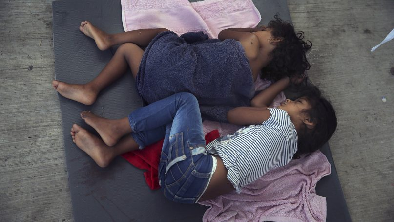 Migrant children en route to the United States sleep on a mattress on the floor of the AMAR migrant shelter in Nuevo Laredo, Mexico, on July 17, 2019. (AP Photo/Marco Ugarte)