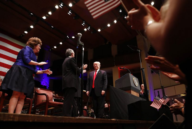 FILE - In this Saturday, July 1, 2017 file photo, President Donald Trump is greeted by Pastor Robert Jeffress of the First Baptist Dallas Church as he arrives to speak during the Celebrate Freedom event at the Kennedy Center for the Performing Arts in Washington. Many religious leaders have strongly condemned Trump's disparaging remarks about minority members of Congress.