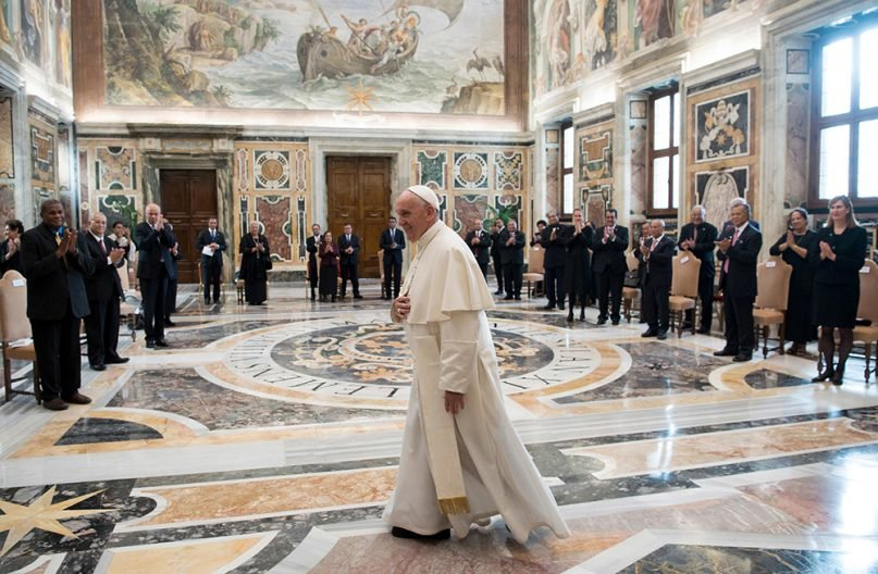FILE - Pope Francis walks in the Clementine Hall after meeting with a delegation of Pacific leaders to discuss climate issues, at the Vatican, on Nov. 11, 2017. Pope Francis will be one of several world leaders to present a joint declaration at the COP26 environmental summit about climate change. (L'Osservatore Romano/Pool Photo via AP)