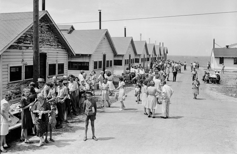 Some of the 982 civilian war refugees from occupied Europe are shown outside the mess hall buildings at Fort Ontario, Oswego, N.Y., on Aug. 5, 1944. The refugees, who arrived in the U.S. on Aug. 4, lived in the emergency relief shelter established by the U.S. War Relocation Authority.  (AP Photo)