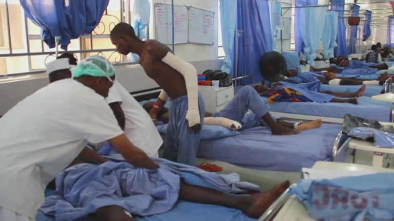 People are treated at Maiduguri General Hospital, July 29, 2019, in Maiduguri, Nigeria, after Saturday's deadly attack by suspected Boko Haram extremists. More than 60 people were killed and many more injured in an attack on villagers leaving a funeral in northeastern Nigeria, in the deadliest extremist attack against civilians in the region this year. (AP Photo)