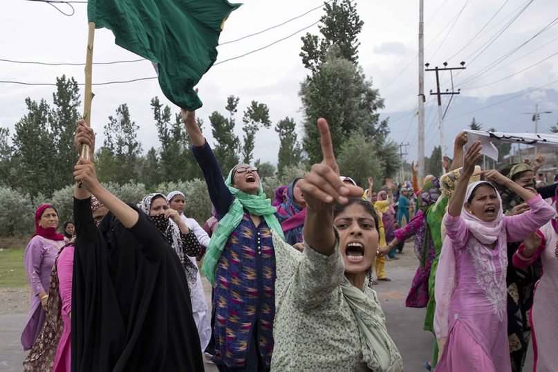 Kashmiri Muslim women shout slogans and march on a street after Friday prayers in Srinagar, Indian-controlled Kashmir, on Aug. 9, 2019. A strict curfew in Kashmir in effect for a fifth day was eased Friday to allow residents to pray at mosques, officials said, but some protests still broke out in the disputed region despite thousands of security forces in the streets as tensions remained high with neighboring Pakistan. (AP Photo/ Dar Yasin)