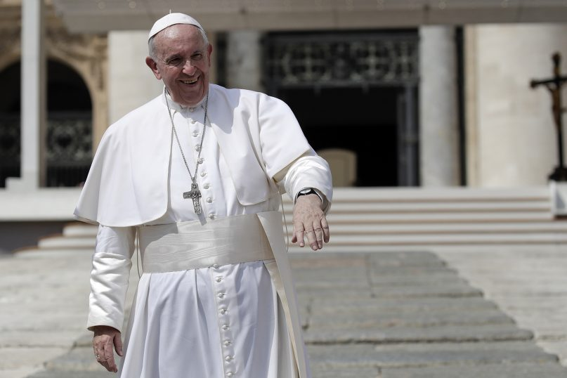 Pope Francis greets pilgrims and faithful as he leaves St. Peter's Square at the Vatican after his weekly general audience on Aug. 28, 2019. (AP Photo/Alessandra Tarantino)