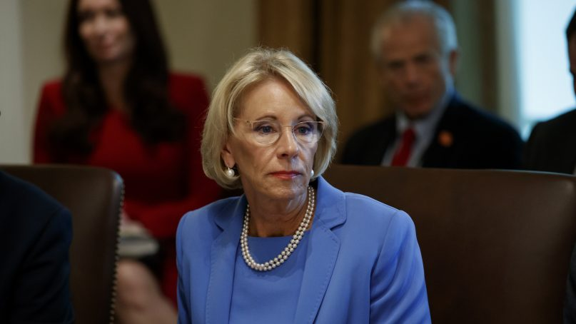 Education Secretary Betsy DeVos listens during a Cabinet meeting in the Cabinet Room of the White House, Tuesday, July 16, 2019, in Washington. (AP Photo/Alex Brandon)