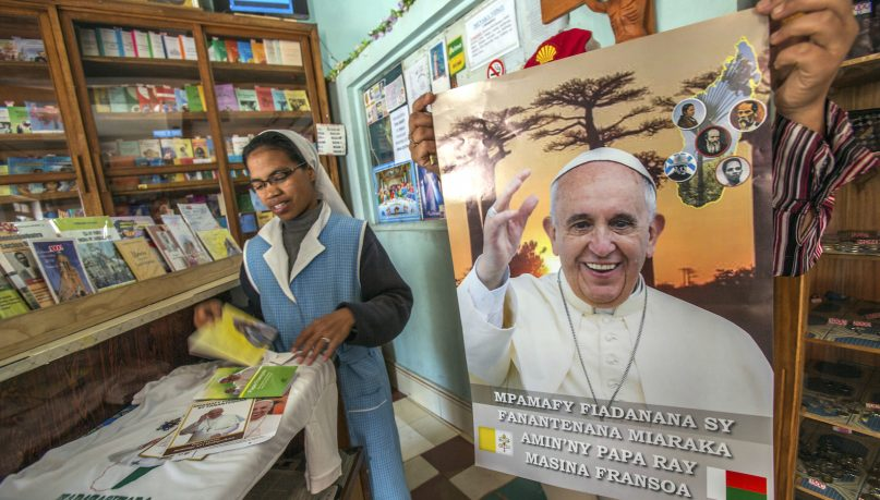 A nun in a store with Pope paraphernalia in Antananarivo Tuesday, Sept. 3, 2019. Pope Francis heads this week to the southern African nations of Mozambique, Madagascar and Mauritius, visiting some of the world's poorest countries that have been hard-hit by some of his biggest concerns: conflict, corruption and climate change. (AP Photo/Alexander Joe)