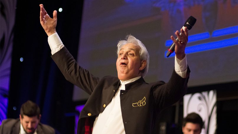 Pastor Benny Hinn leads a service on Jan. 27, 2014.  Photo courtesy of House of Praise/Creative Commons