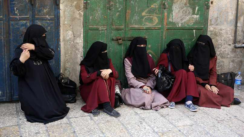 """College students at the entrance to the Al-Aqsa Mosque compound (Haram-Al-Sharif), in 2013, part of the exhibition """"Veiled Women of the Holy Land: New Trends in Modest Dress."""" Photo by Menahem Kahana"""