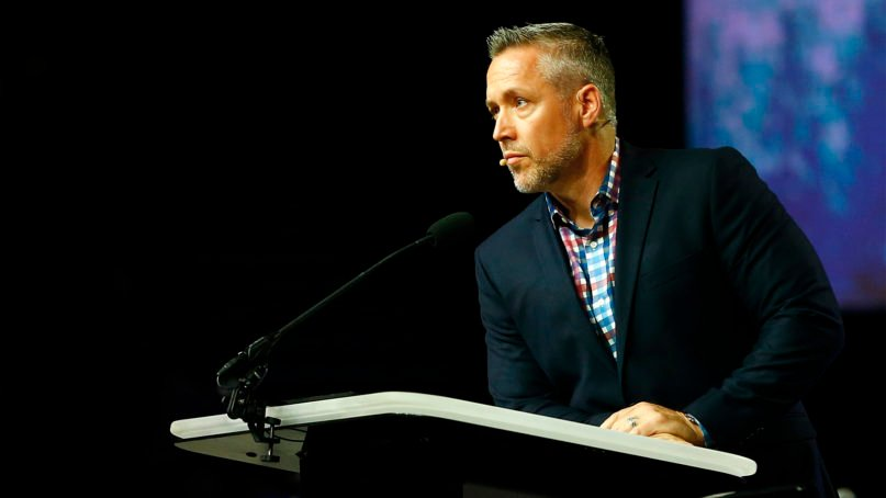 SBC President J.D. Greear addresses a question before a vote during the annual meeting of the Southern Baptist Convention at the Birmingham-Jefferson Convention Complex on June 11, 2019, in Birmingham, Alabama.  RNS photo by Butch Dill