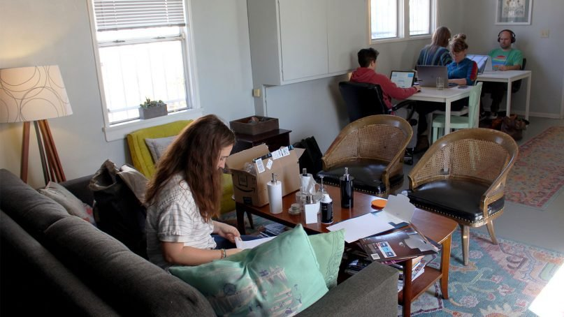 People work in Epiphany Space's open workspace in Hollywood. RNS photo by Heather Adams