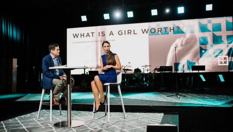 Abuse survivor Rachael Denhollander, right, discusses the Southern Baptist Convention's history of addressing sexual abuse with ERLC President Russell Moore at the Caring Well conference in Dallas, on Oct. 4, 2019. Photo by Karen Race Photography 2019