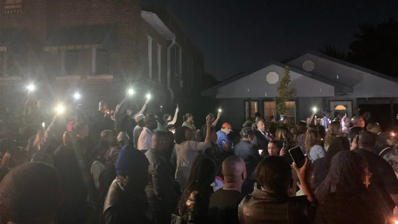 People gather for a vigil at the home, right, where Atatiana Jefferson was killed in Fort Worth, Texas. A local mosque is on the left. Photo courtesy of Imam Omar Suleiman