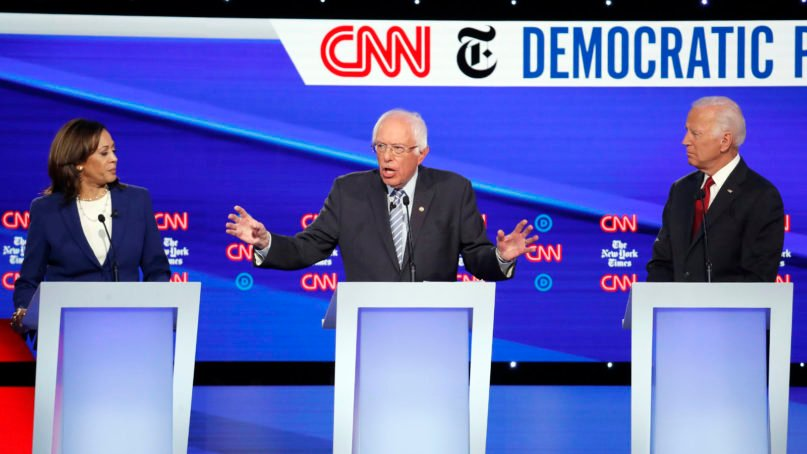 Democratic presidential candidate Sen. Kamala Harris, D-Calif., left, Sen. Bernie Sanders, I-Vt., and former Vice President Joe Biden, right, participate in a Democratic presidential primary debate hosted by CNN/New York Times at Otterbein University, Tuesday, Oct. 15, 2019, in Westerville, Ohio. (AP Photo/John Minchillo)