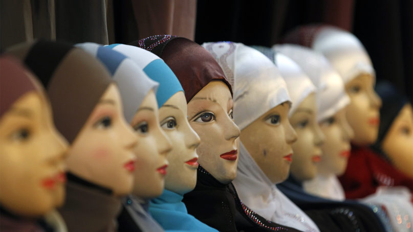 In this Dec. 17, 2011, file photo, mannequins with veils are seen on display at an exhibition hall for the Muslim World Fair in Le Bourget, outside Paris. France's Senate is voting Tuesday Oct. 29, 2019 on a bill that would forbid Muslim mothers from wearing headscarves on school field trips, amid resurgent tensions around the country's unusually strict interpretation of secularism. (AP Photo/Christophe Ena, file)