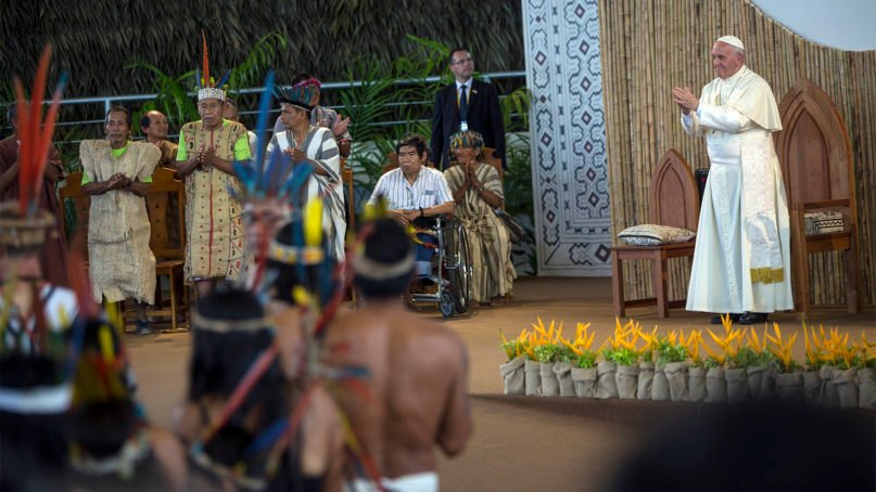 Pope Francis meets with indigenous representatives in Puerto Maldonado, Peru, on Jan. 19, 2018. Standing with thousands of indigenous Peruvians, Francis declared the Amazon the