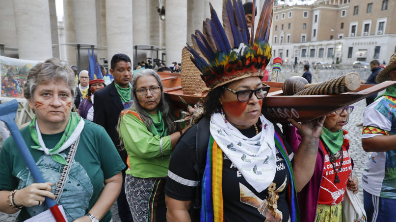 Participants in the Amazon synod arrive in St. Peter's Square, at the Vatican, Monday, Oct. 7, 2019. Pope Francis opened a three-week meeting on preserving the rainforest and ministering to its native people as he fended off attacks from conservatives who are opposed to his ecological agenda. (AP Photo/Andrew Medichini)
