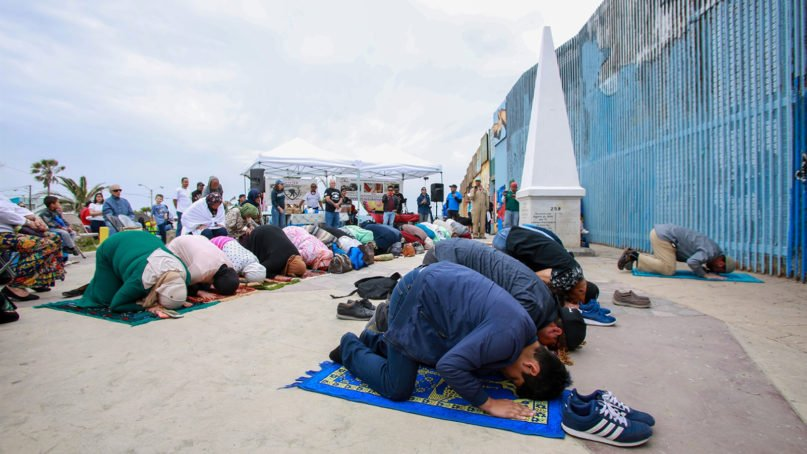 Since April, groups of Muslims have joined Border Church in prayer along the U.S.-Mexico border near San Diego. They gather on the last Sunday of the month and cross to the Mexico side for what's referred to as Border Mosque. Photo courtesy of CAIR - San Diego