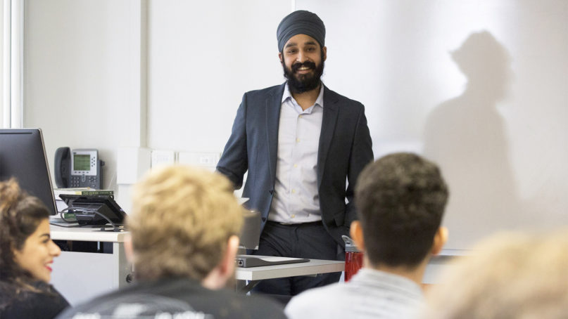 Simran Jeet Singh interacts with his students during class at Trinity University in San Antonio on Jan. 12, 2017. Photo courtesy of San Antonio Express-News/Ray Whitehouse