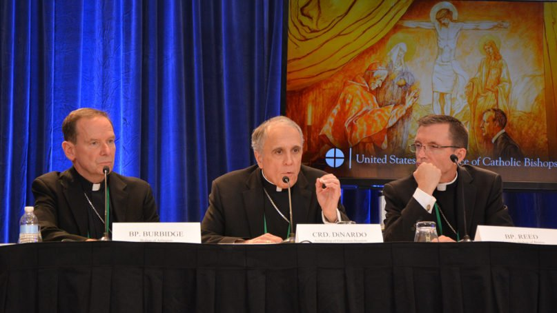 Cardinal Daniel DiNardo, center, speaks during the first day of the U.S. Conference of Catholic Bishops annual fall meeting, Monday, Nov. 11, 2019, in Baltimore. RNS photo by Jack Jenkins