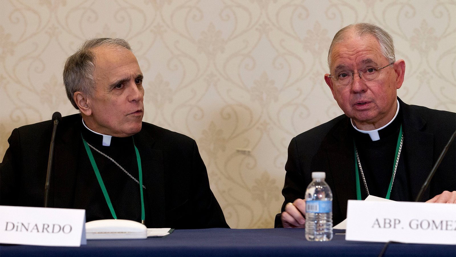Cardinal Daniel DiNardo, left, of the Archdiocese of Galveston-Houston, and Archbishop José Gomez, of Los Angeles, speak during a news conference at the United States Conference of Catholic Bishops (USCCB) 2019 Spring meetings in Baltimore, Tuesday, June 11, 2019. (AP Photo/Jose Luis Magana)