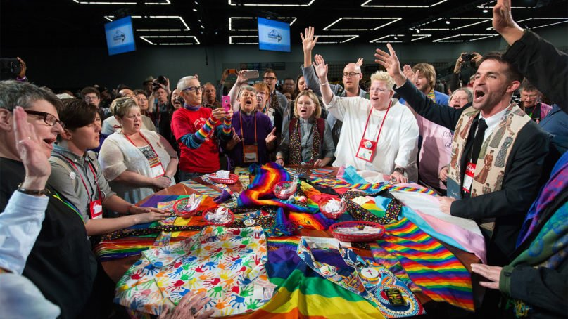 Supporters of LGBTQ rights in the United Methodist Church rally around the central Communion table at the close of the 2016 United Methodist General Conference in Portland, Oregon. Photo by Mike DuBose/UM News Service