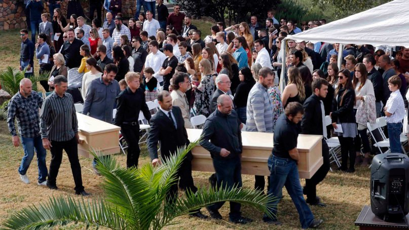 Men carry the remains of Dawna Ray Langford, 43, and her sons Trevor, 11, and Rogan, 2, who were killed by drug cartel gunmen, before they are buried at a family cemetery in La Mora, Sonora state, Mexico, on Nov. 7, 2019. Three women and six of their children, all members of the extended LeBaron family, died when they were gunned down in an attack while traveling along Mexico's Chihuahua and Sonora state border on Nov. 4, 2019. (AP Photo/Marco Ugarte)