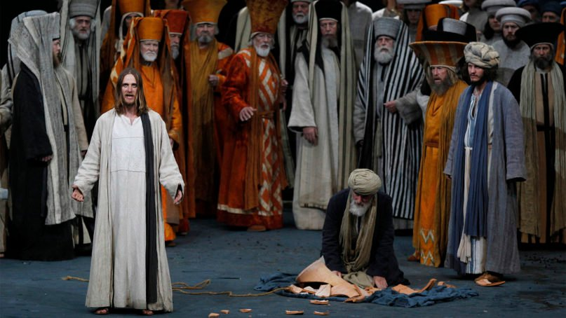 Frederik Mayet as Jesus, left, performs with laymen during a dress rehearsal of the Oberammergau Passion Play in the theatre of Oberammergau, southern Germany, on May 10, 2010. More than 2,000 citizens of this Bavarian village participate in the century-old play of the suffering of Christ, staged every ten years and dating back to 1634. (AP Photo/Matthias Schrader)