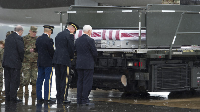 Vice President Mike Pence joins military officers and a chaplain on Aug. 23, 2019, in a prayer for two Army men who died during operations in Afghanistan. (AP Photo/Cliff Owen)