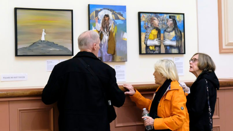 """Visitors from Trinity Episcopal Cathedral in Little Rock, Arkansas, view art in the """"Abraham: Out of One, Many"""" exhibition at St. Paul Cathedral in Boston. RNS photo by Aysha Khan"""
