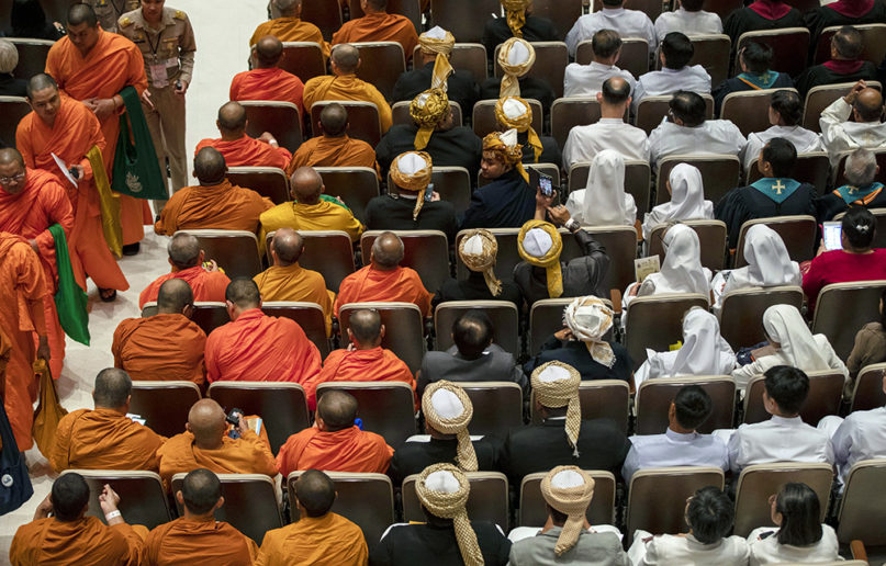 Buddhist monks, left, arrive to participate in an interfaith meeting with Pope Francis at Chulalongkorn University on Nov. 22, 2019, in Bangkok. (AP Photo/Gemunu Amarasinghe)