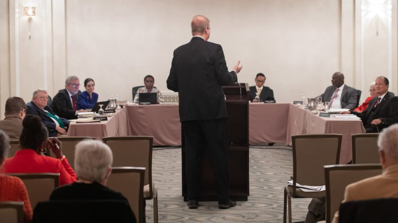 Bishop Kenneth H. Carter (standing) speaks during an oral hearing before the United Methodist Judicial Council meeting in Evanston, Ill. Carter is president of the denomination's Council of Bishops. Photo by Mike DuBose/UM News