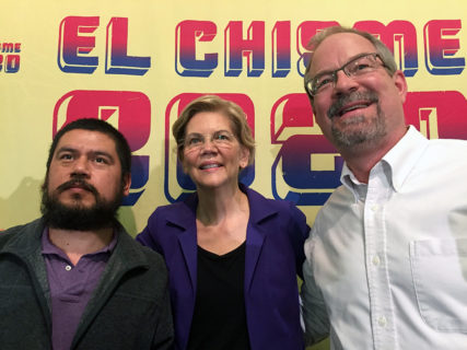 FILE - Eliseo Jimenez, left, poses with Sen. Elizabeth Warren and church pastor Douglas Long in Raleigh on Friday Nov. 8, 2019. Jimenez took sanctuary in the church to avoid deportation several years ago and has been living in the church ever since. RNS photo by Yonat Shimron