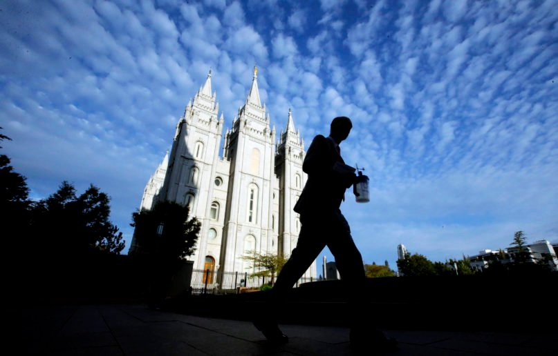 A man walks past the Salt Lake Temple, a temple of The Church of Jesus Christ of Latter-day Saints, at Temple Square in Salt Lake City, Sept. 14, 2016. (AP Photo/Rick Bowmer)