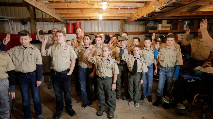 In this Dec. 12, 2019, photo, a Boy Scout troop gathers for a meeting in Kaysville, Utah. For decades, The Church of Jesus Christ of Latter-day Saints was one of Boy Scouts of America's greatest allies and the largest sponsor of troops.  (AP Photo/Rick Bowmer)