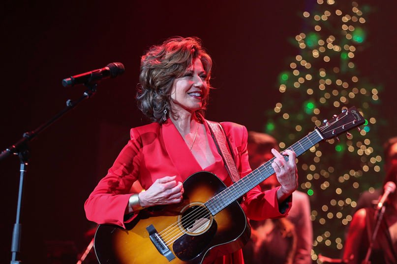 """Amy Grant performs at a """"Christmas at the Ryman"""" show at Ryman Auditorium on Dec. 17, 2019, in Nashville, Tenn. (Photo by Al Wagner/Invision/AP)"""