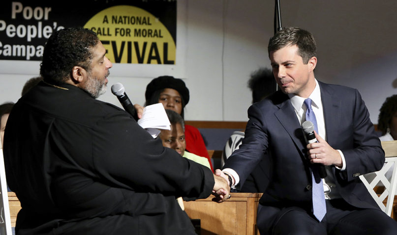 Democratic presidential candidate Mayor Pete Buttigieg, right, shakes hands with Rev. William J. Barber at Greenleaf Christian Church in Goldsboro, N.C., Dec. 1, 2019. (The News & Observer via AP)