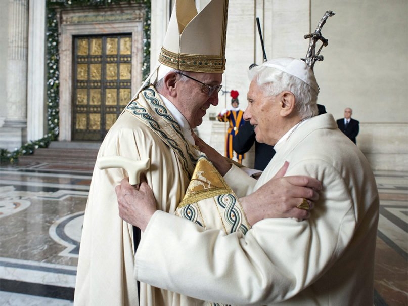 Pope Francis, left, embraces Pope Emeritus Benedict XVI before opening the Holy Door to mark the start of the Catholic Holy Year, or Jubilee, in St. Peter's Basilica, at the Vatican, on Dec. 8, 2015. (Photo by Osservatore Romano/Handout via AP)