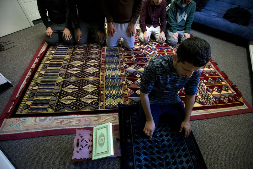Gallaudet University student Abdulrahman Alshehri, front, along with other students during Muslim prayer at Gallaudet University in Washington, Thursday, Dec. 12, 2019. Gallaudet University is an institution of learning, teaching and research for deaf and hard-of-hearing students. (AP Photo/Jose Luis Magana)