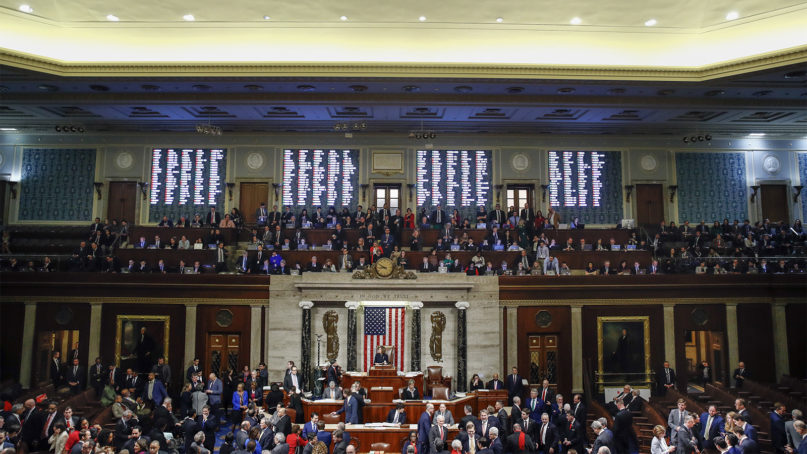 House members vote as House Speaker Nancy Pelosi, of Calif., stands on the dais, during a vote on article II of impeachment against President Donald Trump, Wednesday, Dec. 18, 2019, on Capitol Hill in Washington. (AP Photo/Patrick Semansky)